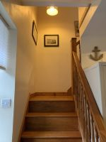 wooden staircase with beach pictures
