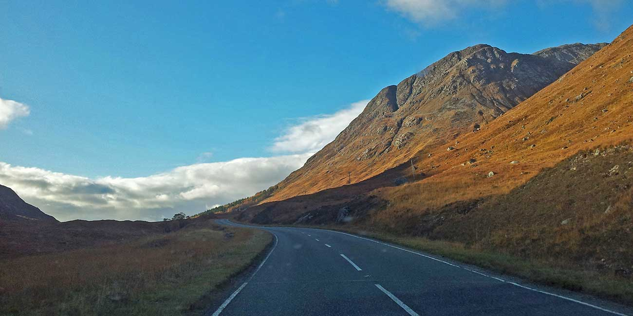 a Highland road leading into a glen