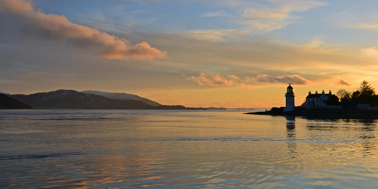 sunset over Corran Narrows and lighthouse